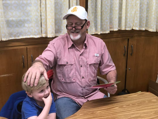 Billy Cantrell of Englewood Baptist Church gleefully rubs Noah Borden's head at Community Montessori on Tuesday. Each kindergarten class at the schools was challenged to read 100 books in 30 minutes. In all, the four classes read 1,013.