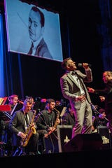 The orchestra performs songs from the Frank Sinatra era of music in the 20th century.