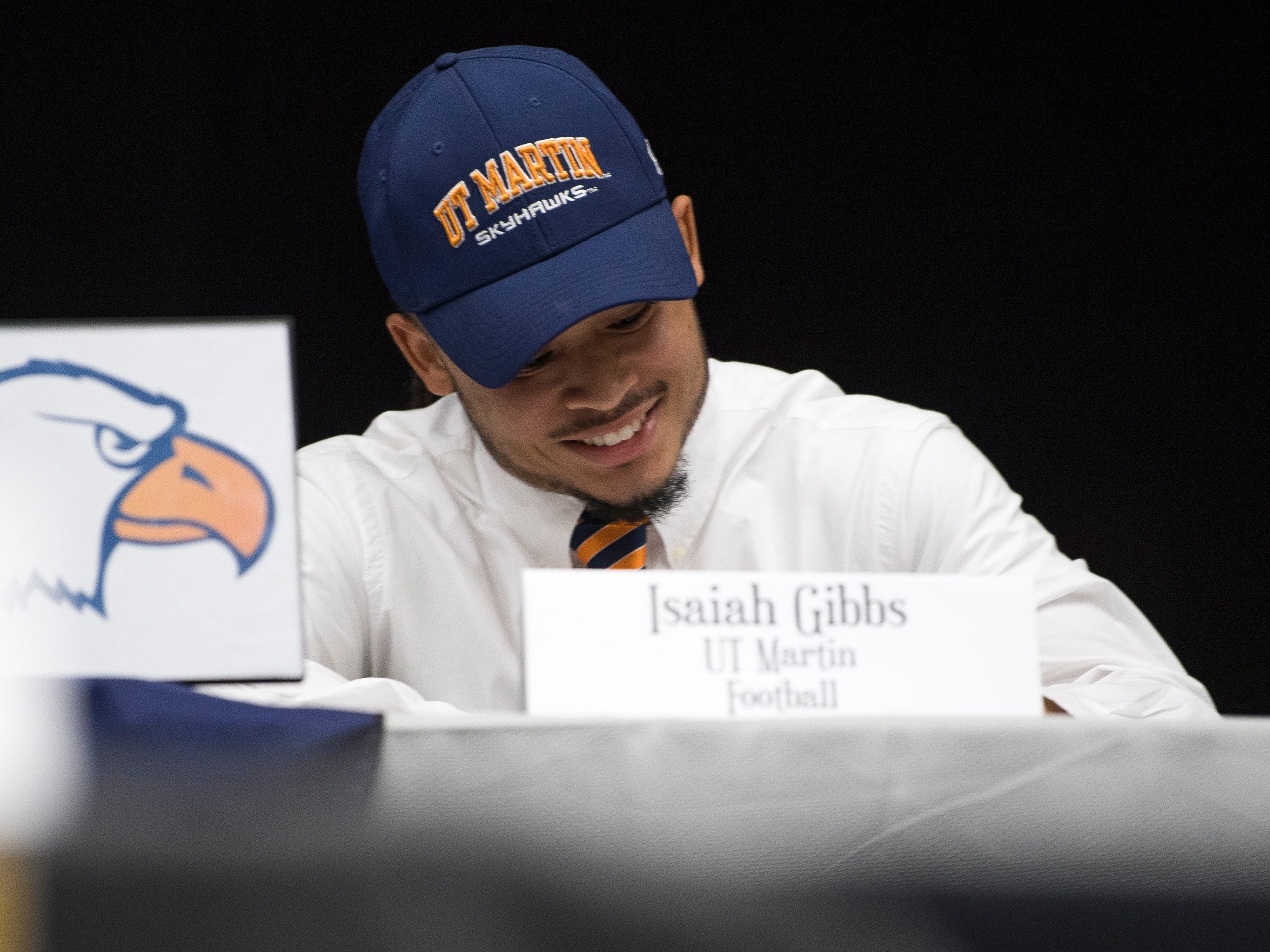 Farragut football player Isiah Gibbs signs with UT-Martin during a National Signing Day event at Farragut High's auditorium on Wednesday, February 6, 2019.