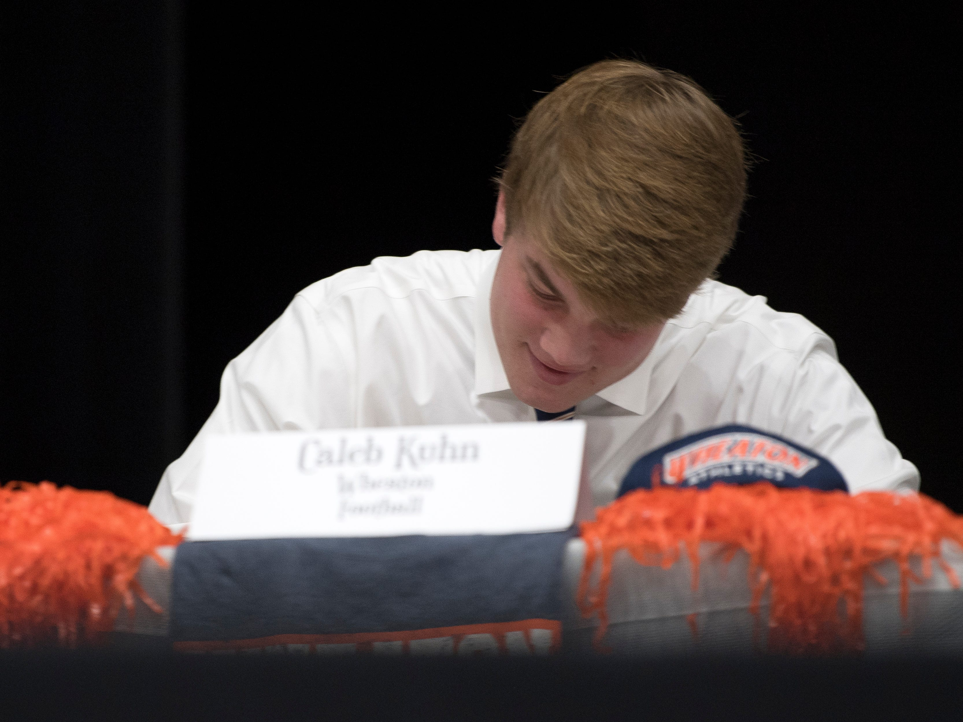 Farragut football player Caleb Kuhn signs with Wheaton College during a National Signing Day event at Farragut High's auditorium on Wednesday, February 6, 2019.