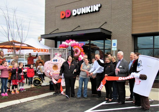 A crowd joined Town of Farragut officials to welcome Dunkin' Donuts at the ribbon cutting on February 2.