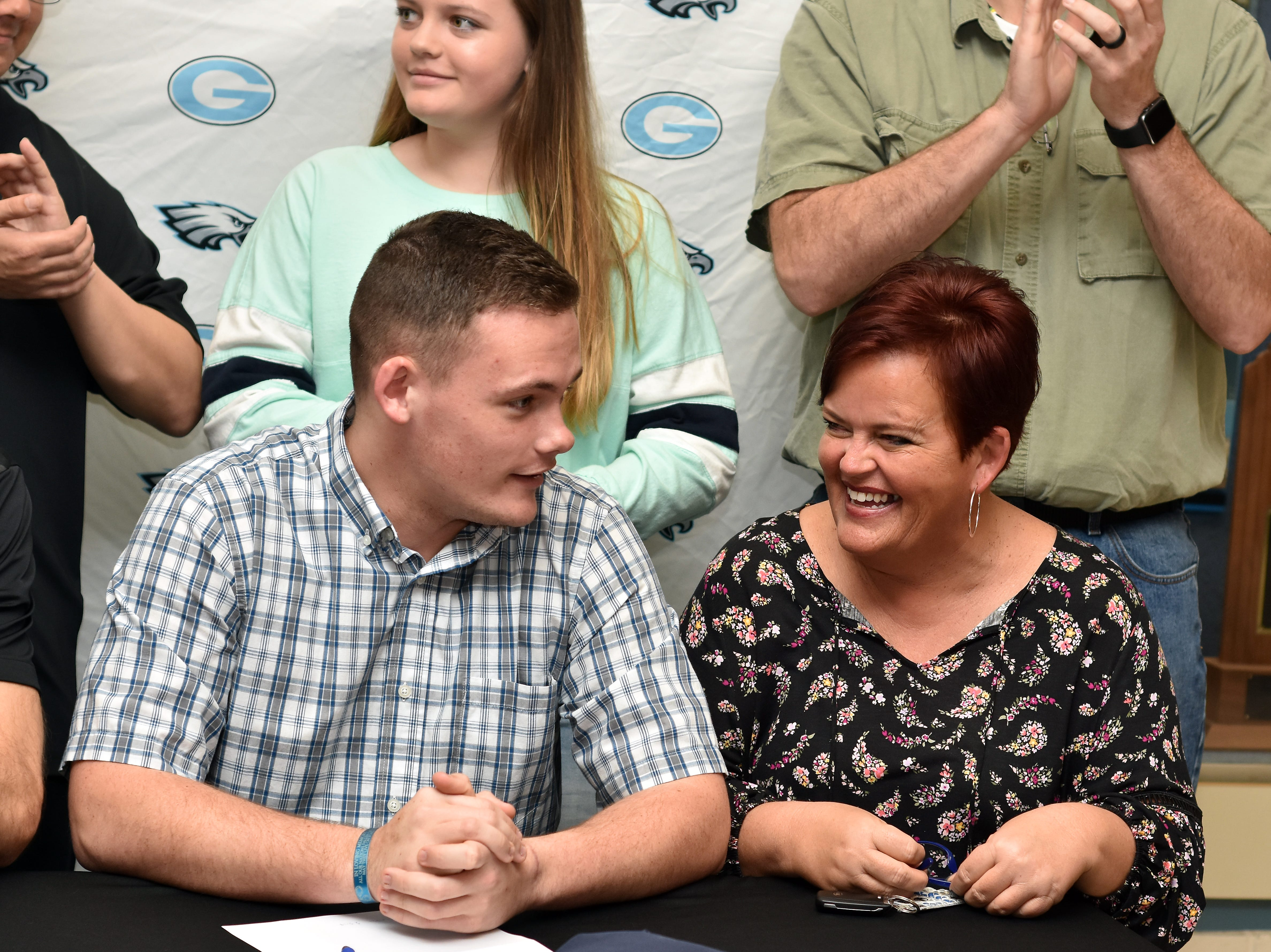Chase Christian and his mom, Kim, share a laugh on National Signing Day 2019. Chase signed with the University of the Cumberlands to play soccer.
