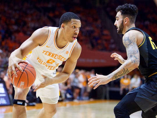Tennessee's Grant Williams (2) is guarded by Missouri's Jordan Geist on Tuesday.