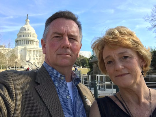 D.J. and Wendy Corcoran stand in front Capitol Hill in Washington, D.C., the day after President Trump's State of the Union address, which they were invited to by Sen. Marsha Blackburn and Rep. Tim Burchett.