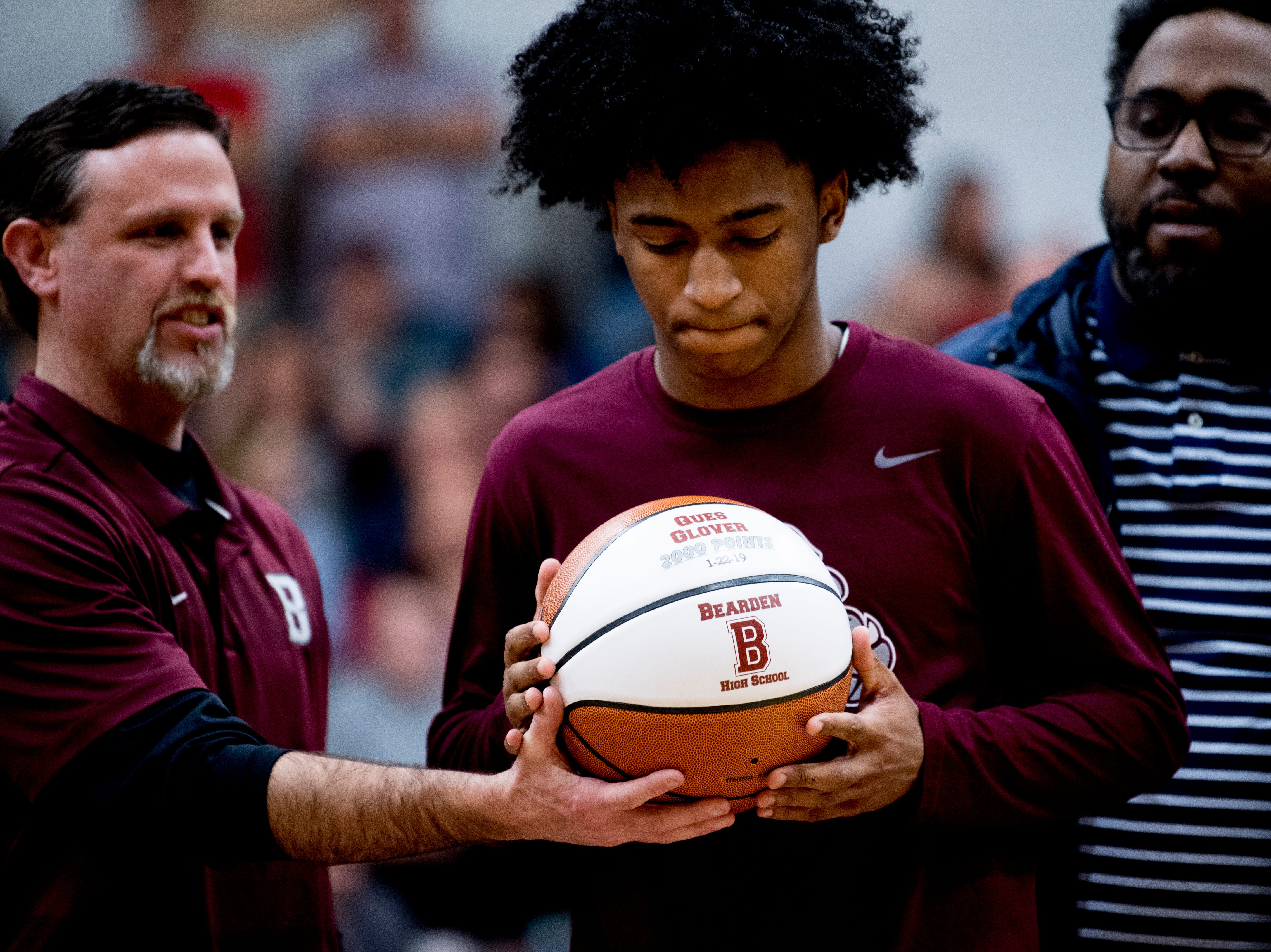Bearden's Ques Glover (0) is handed his 2000 point celebratory ball during a game between Bearden and Maryville at Bearden High School in Knoxville, Tennessee on Tuesday, February 5, 2019.