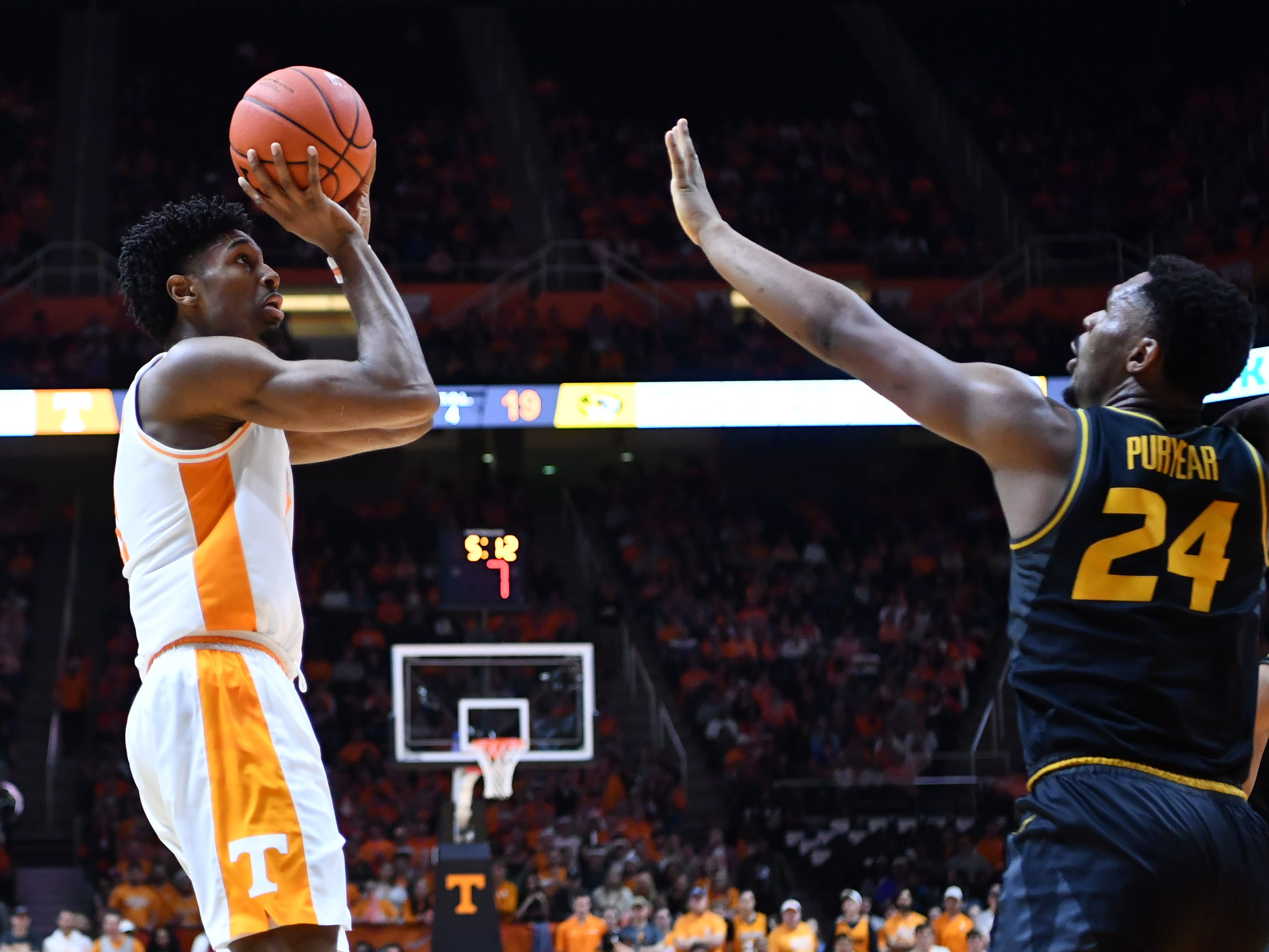 Tennessee's Kyle Alexander (11) takes a shot while guarded by Missouri's Kevin Puryear (24) on Tuesday, February 5, 2019.