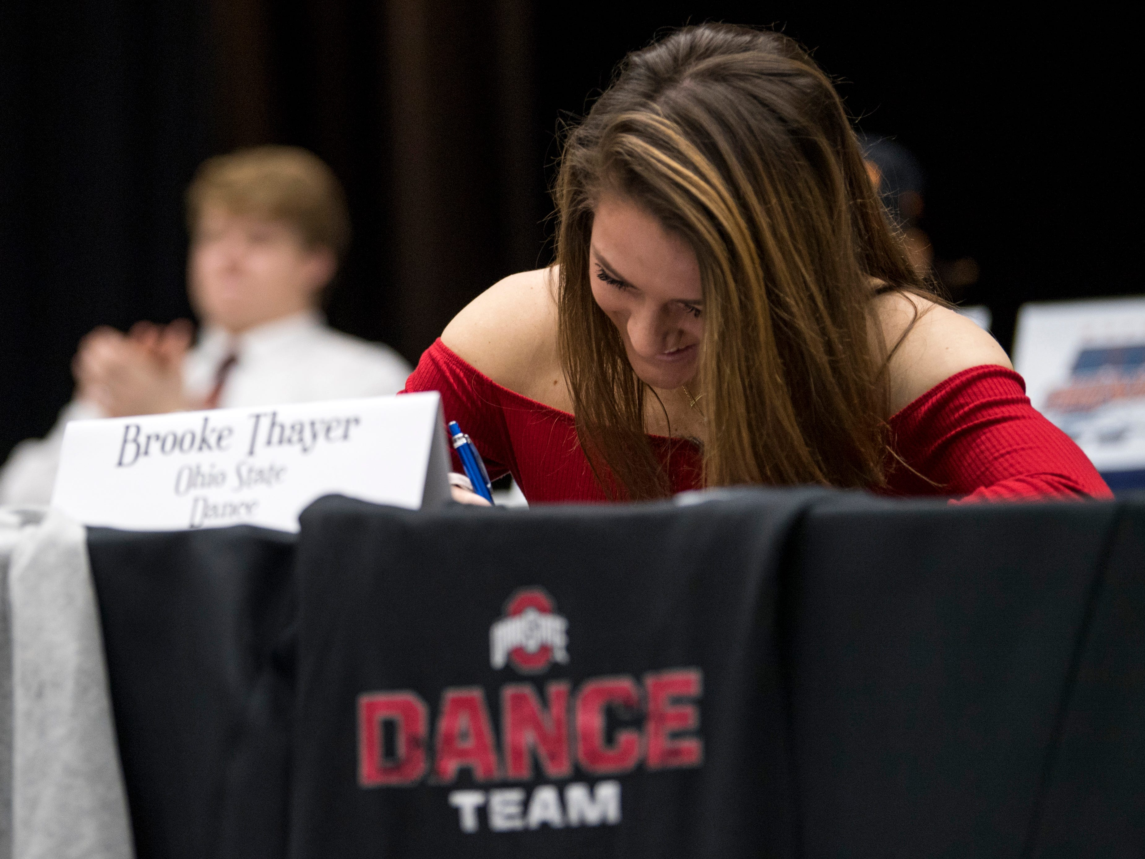 Farragut dancer Brooke Thayer signs with Ohio State University during a National Signing Day event at Farragut High's auditorium on Wednesday, February 6, 2019.