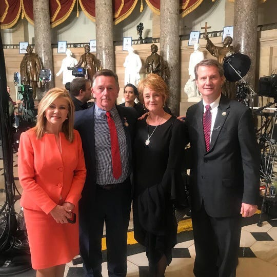 Sen. Marsha Blackburn, R-Tenn, is joined by KFD Capt. D.J. Corcoran and his wife Wendy Corcoran and Congressman Tim Burchett, R-Knoxville, at the State of the Union on Tuesday.