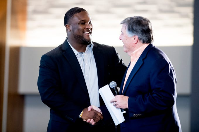 Tee Martin is welcomed on stage by Bob Kesling, Director of Broadcasting, during a Tennessee signing day celebration at the UTK Student Union in Knoxville, Tennessee on Wednesday, February 6, 2019.