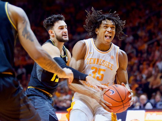 Tennessee's Yves Pons is fouled by Missouri's Jordan Geist on Feb. 5. Pons will miss at least one game after suffering a facial fracture this week.