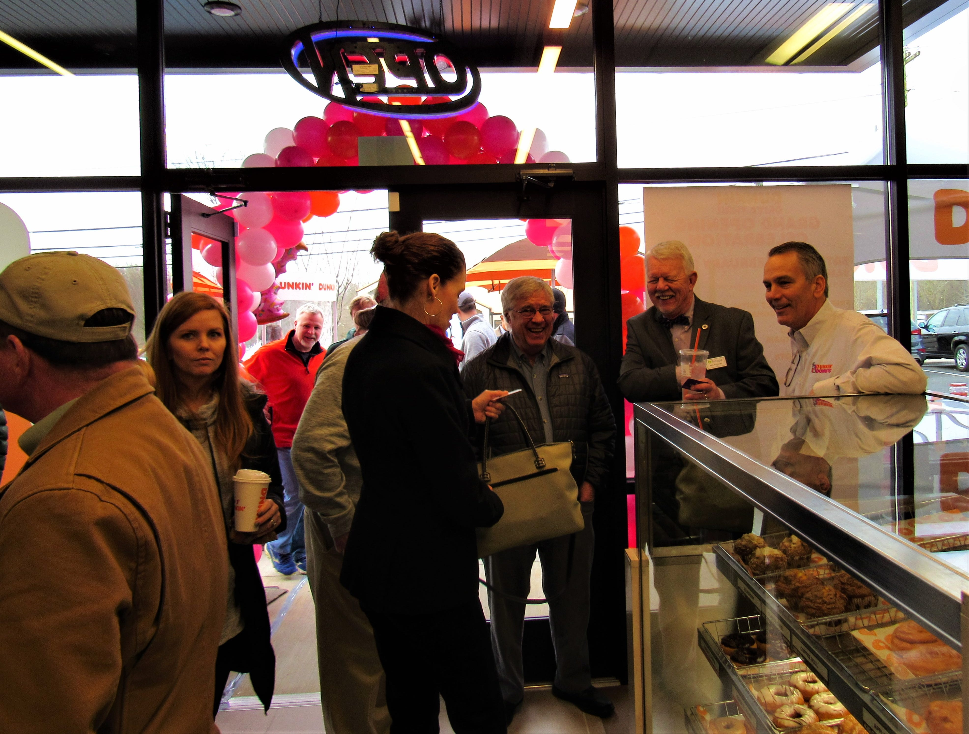 Customers poured into the new Dunkin' Donuts to help celebrate the grand opening and get a quick donut fix.