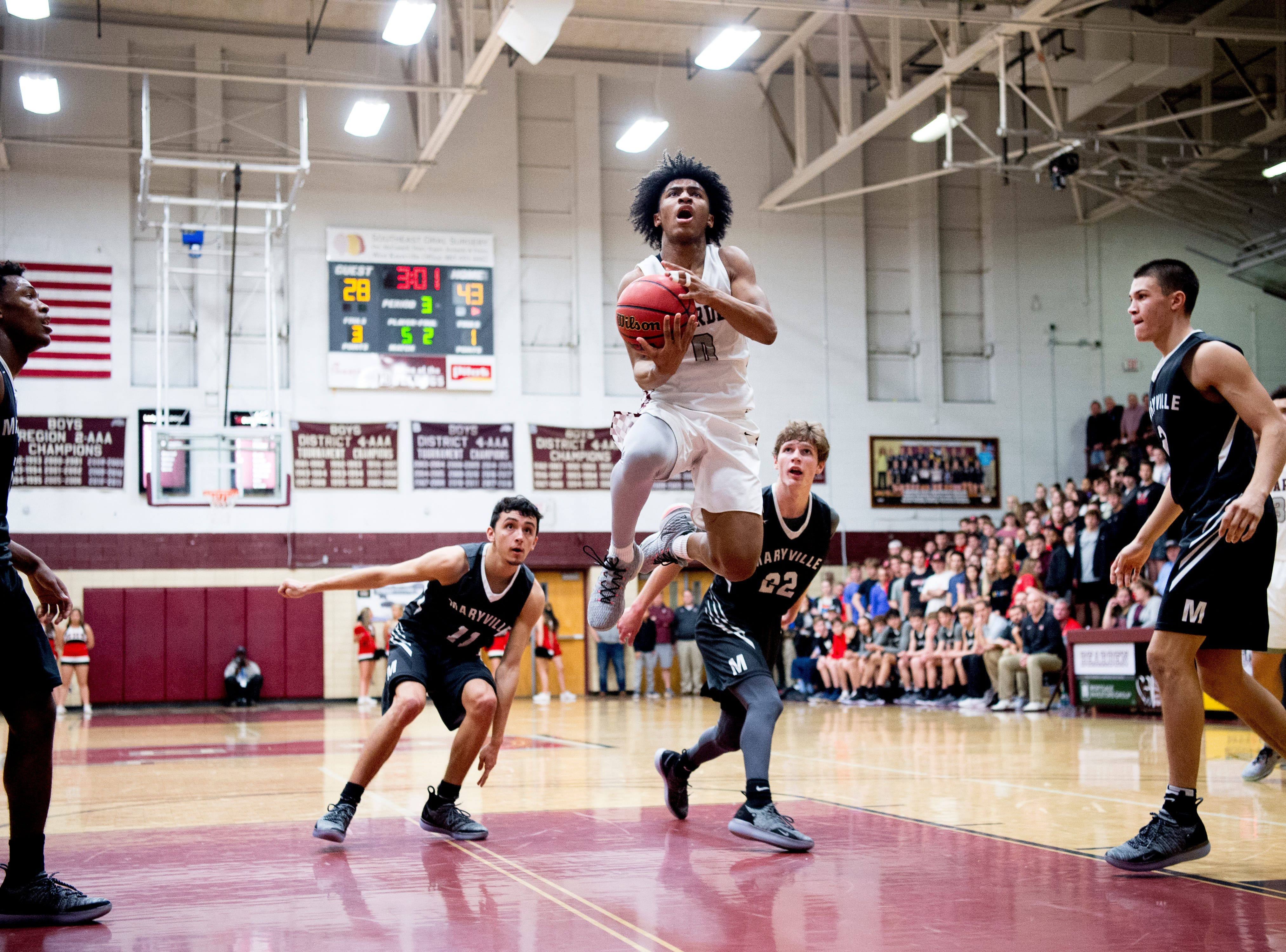 Bearden's Ques Glover (0) goes for a layup during a game between Bearden and Maryville at Bearden High School in Knoxville, Tennessee on Tuesday, February 5, 2019.