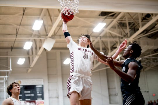 Bearden's Drew Pember (3) dunks the ball during a game between Bearden and Maryville at Bearden High School in Knoxville, Tennessee on Tuesday, February 5, 2019.
