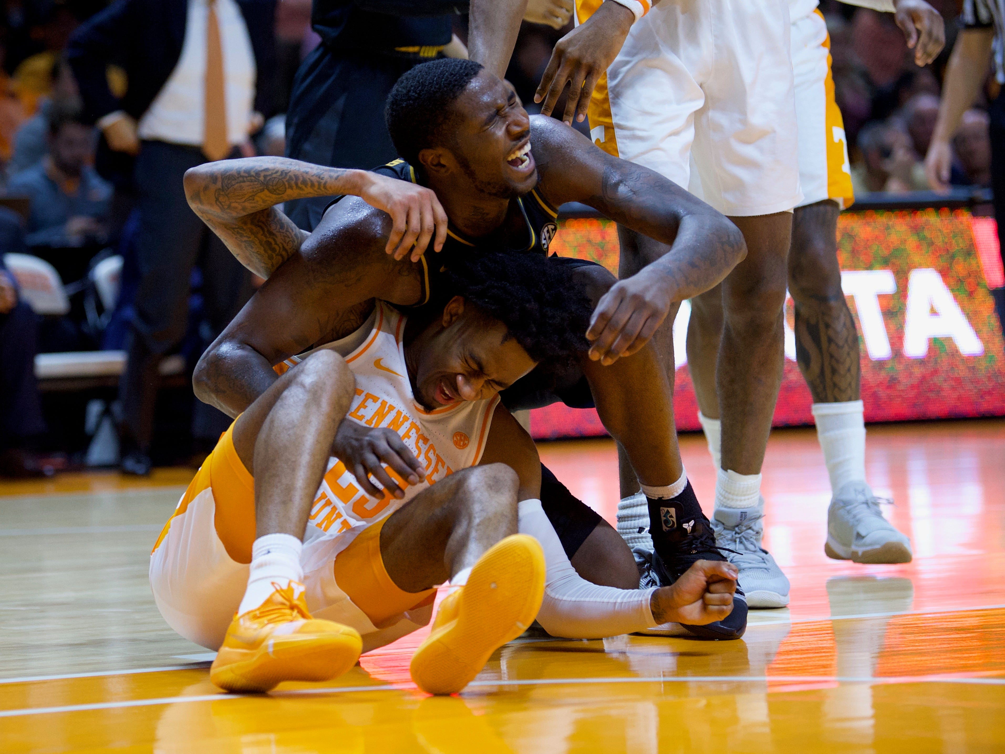 Tennessee's Jordan Bowden (23) and Missouri's Jeremiah Tilmon (23) collide on Tuesday, February 5, 2019.