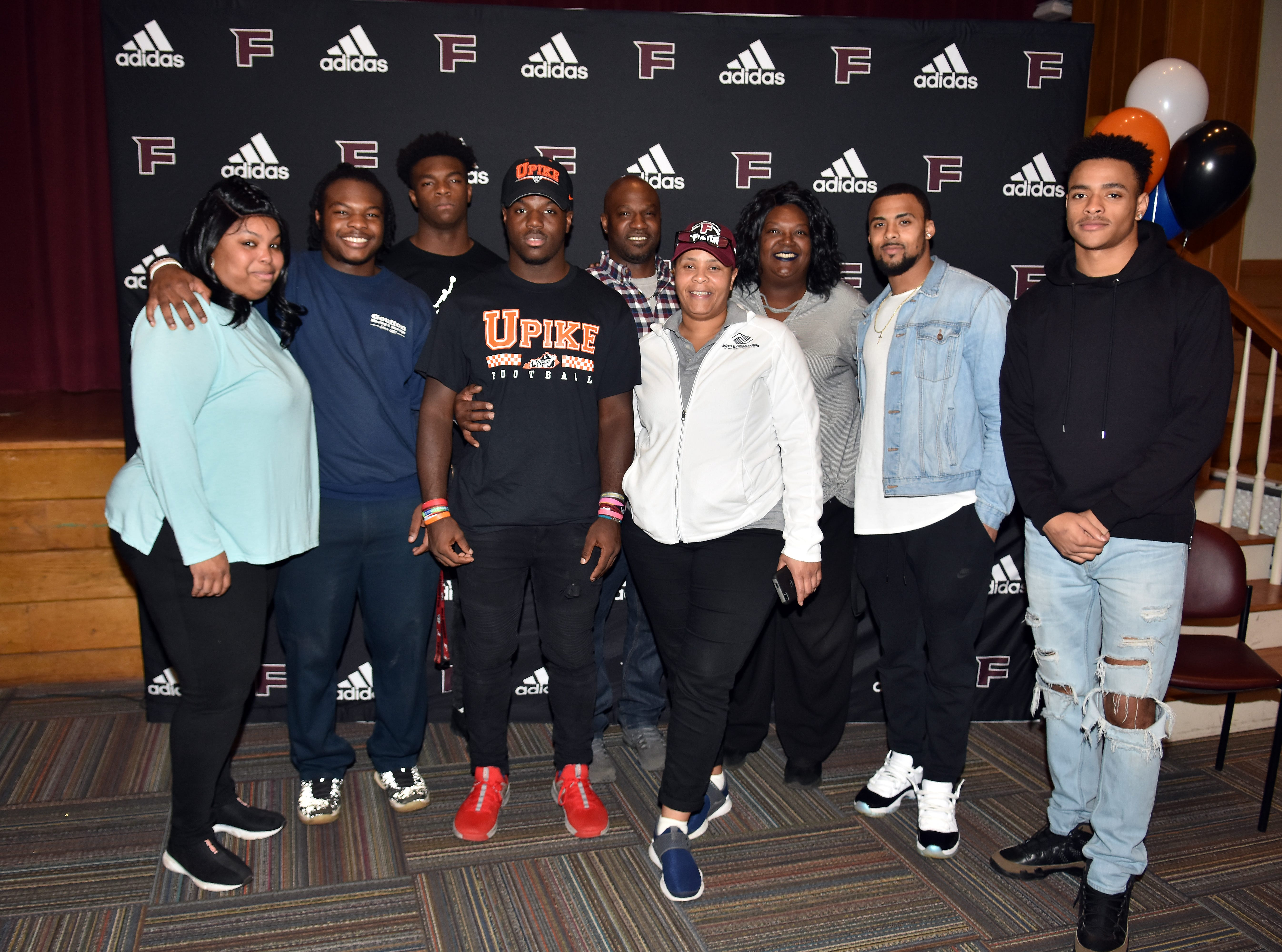 Jashaun Fenderson is surrounded by family on National Signing Day, Wednesday, February 6, 2019. The Fulton High senior signed to play football at University of Pikeville.