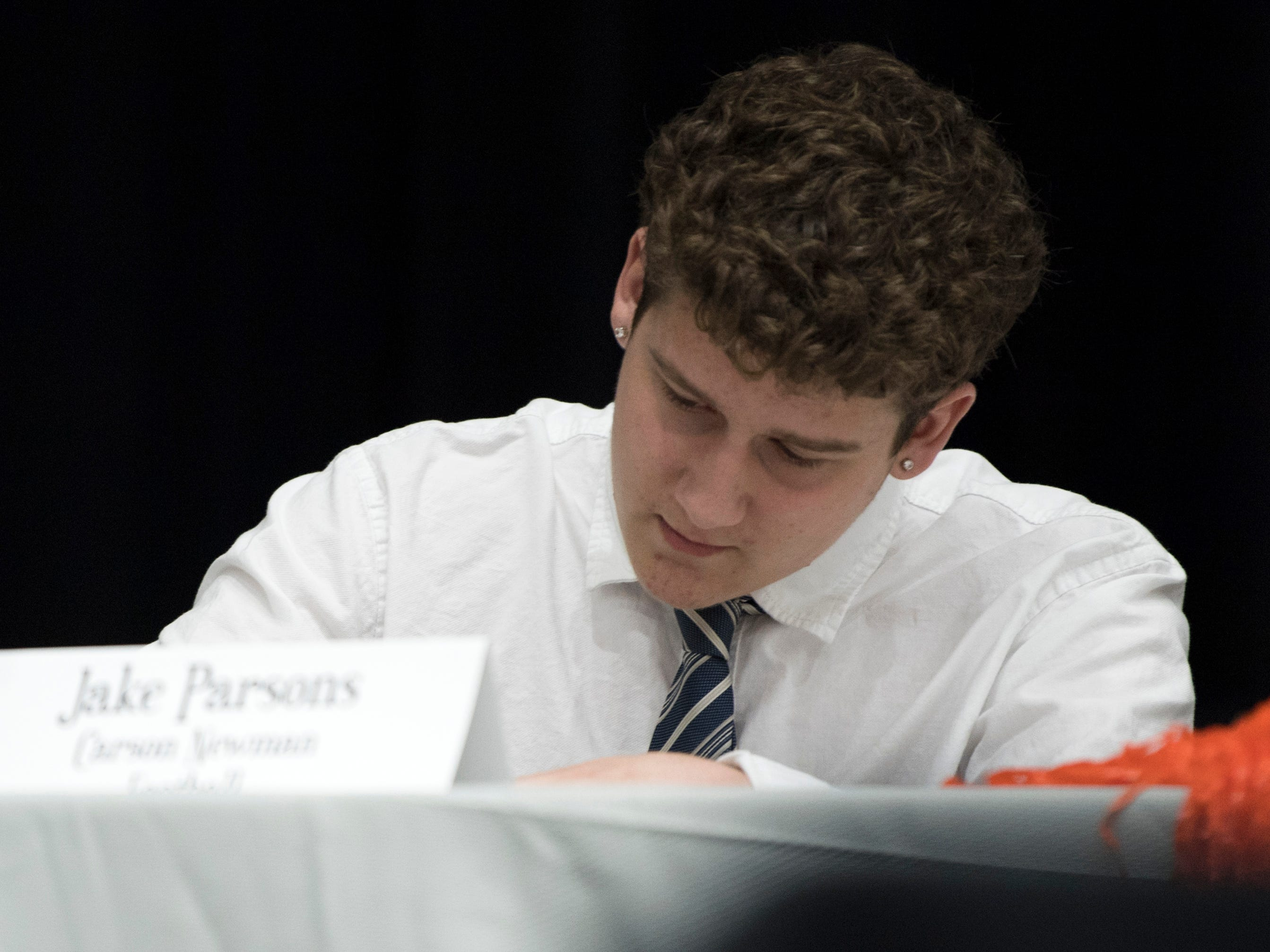 Farragut football player Jake Parsons signs with Carson-Newman University during a National Signing Day event at Farragut High's auditorium on Wednesday, February 6, 2019.