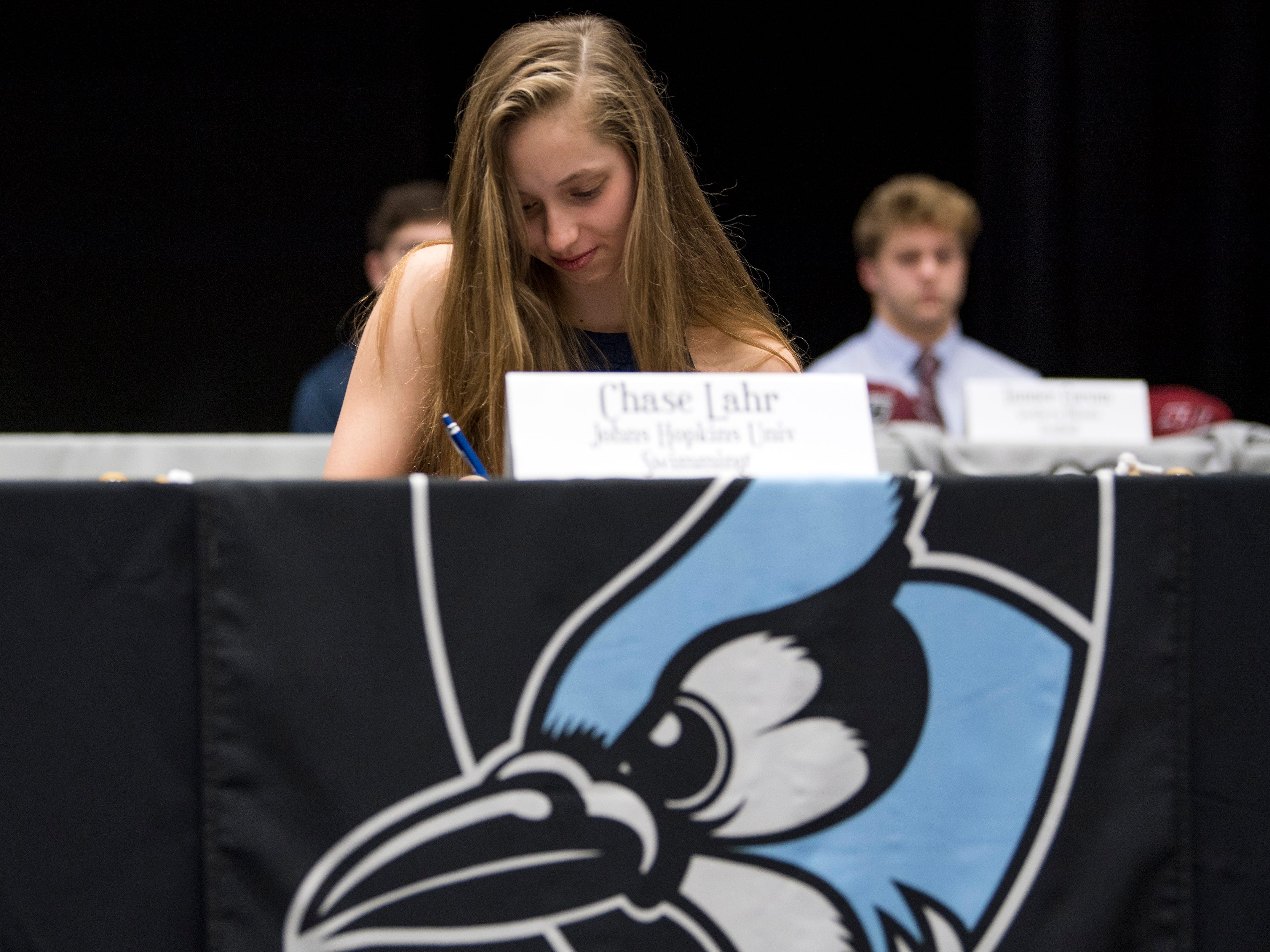 Farragut swimmer Chase Lahr signs with Johns Hopkins University during a National Signing Day event at Farragut High's auditorium on Wednesday, February 6, 2019.