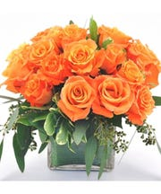 This orange rose bouquet in a square vase is available from Crouch Florist.