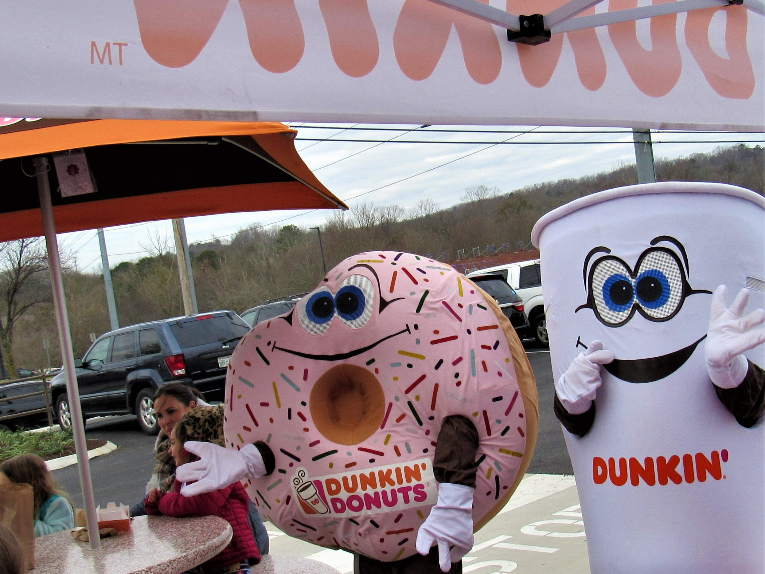 Donut and Cuppy mascots greeted attendees at the event.