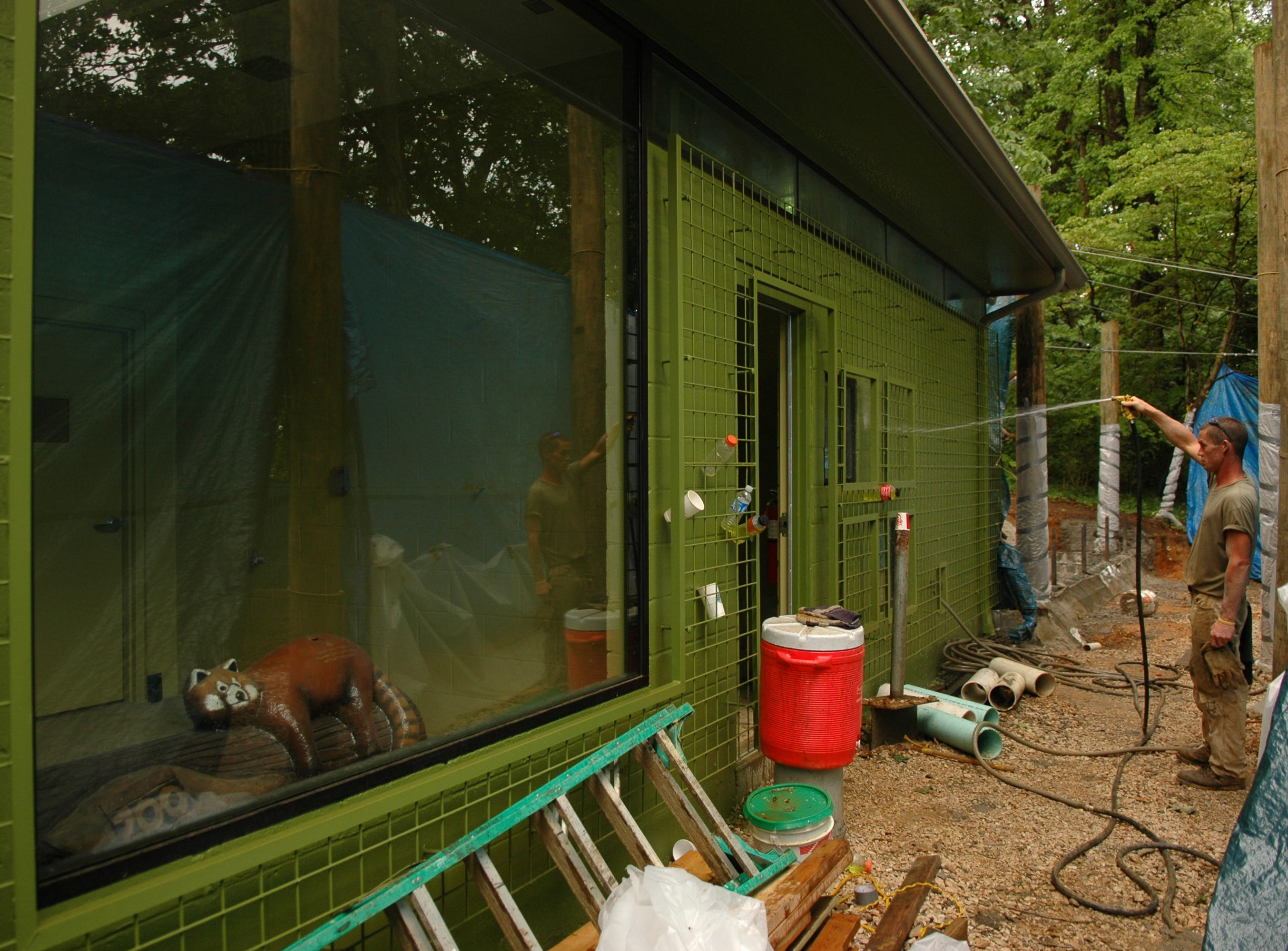 A worker cleans the exterior of the new red panda facilities in the process of being built at the Knoxville Zoo. 