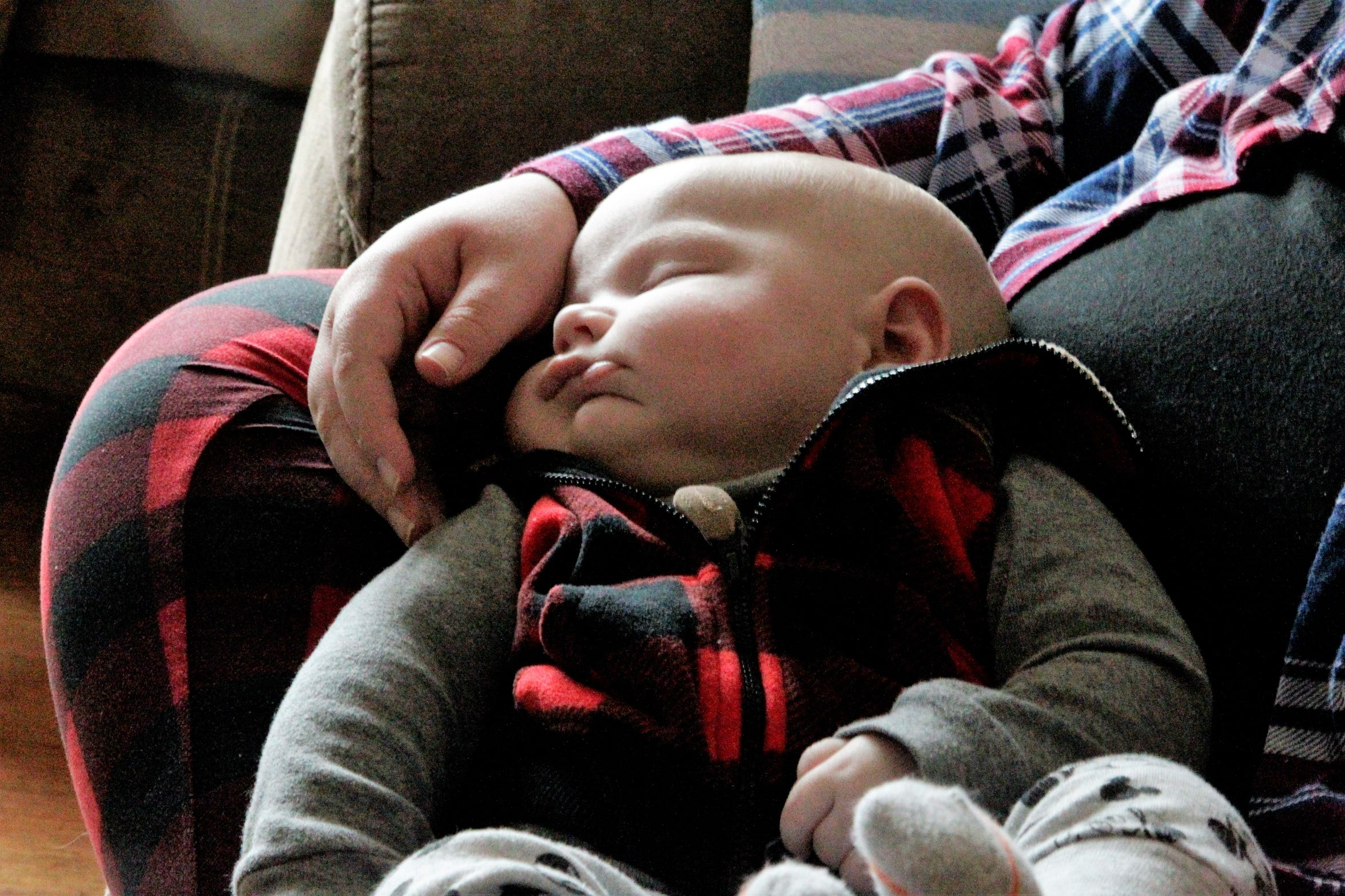 Three month old Austin Glines rests nestled into his mother Heather Glines at their home in Ladoga, Indiana on Tuesday, February 5, 2019.