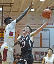 Broncho guard Avery Beaver drives to the goal against James Mallett Tuesday night at McCutcheon.