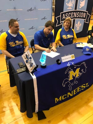 Sean-Michael Brady of Ascension signs a scholarship Wednesday to continue his baseball career at McNeese State.