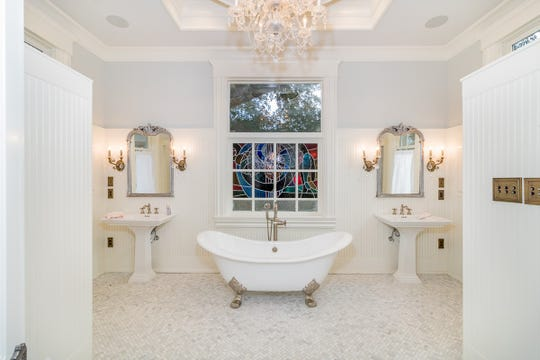 The master bath is full of charm and style.