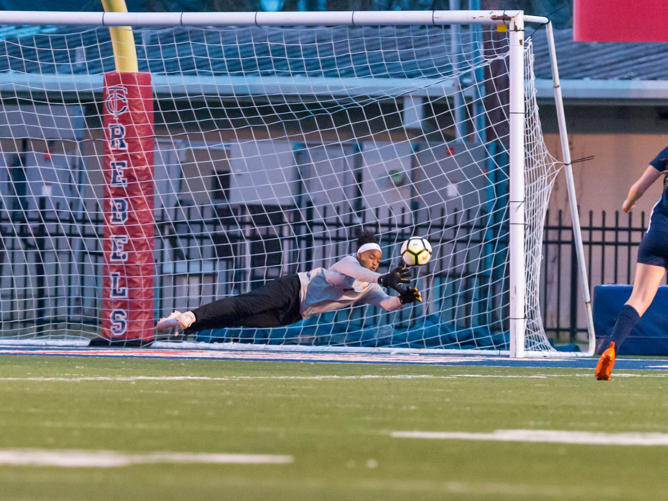 Keeper Lauryn Starwood dives and saves a goal as Teurlings Catholic shuts out Lutcher 8-0 in the second round of the LHSAA soccer playoffs.  Tuesday, Feb. 5, 2019.