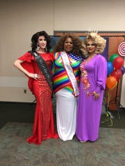 From left to right: Drag queens Santana Pilar Andrews, Roxie C. Black and Kenli Andrews stand together at the Drag Queen Story Time event Sunday, Feb. 3, 2019.