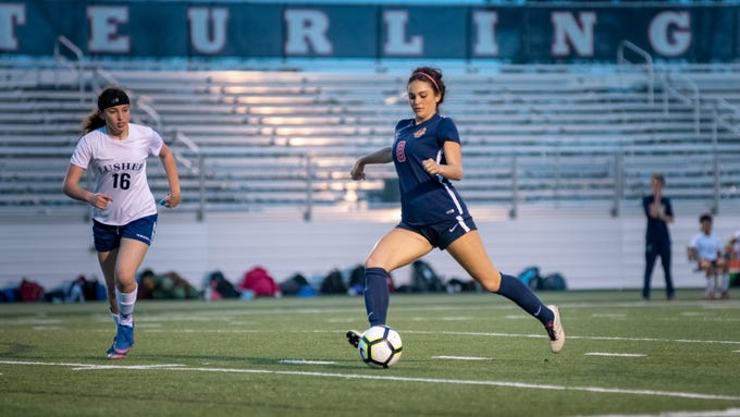 Kaitlyn Poirier takes a shot and scores as Teurlings Catholic shuts out Lutcher 8-0 in the second round of the LHSAA soccer playoffs.  Tuesday, Feb. 5, 2019.