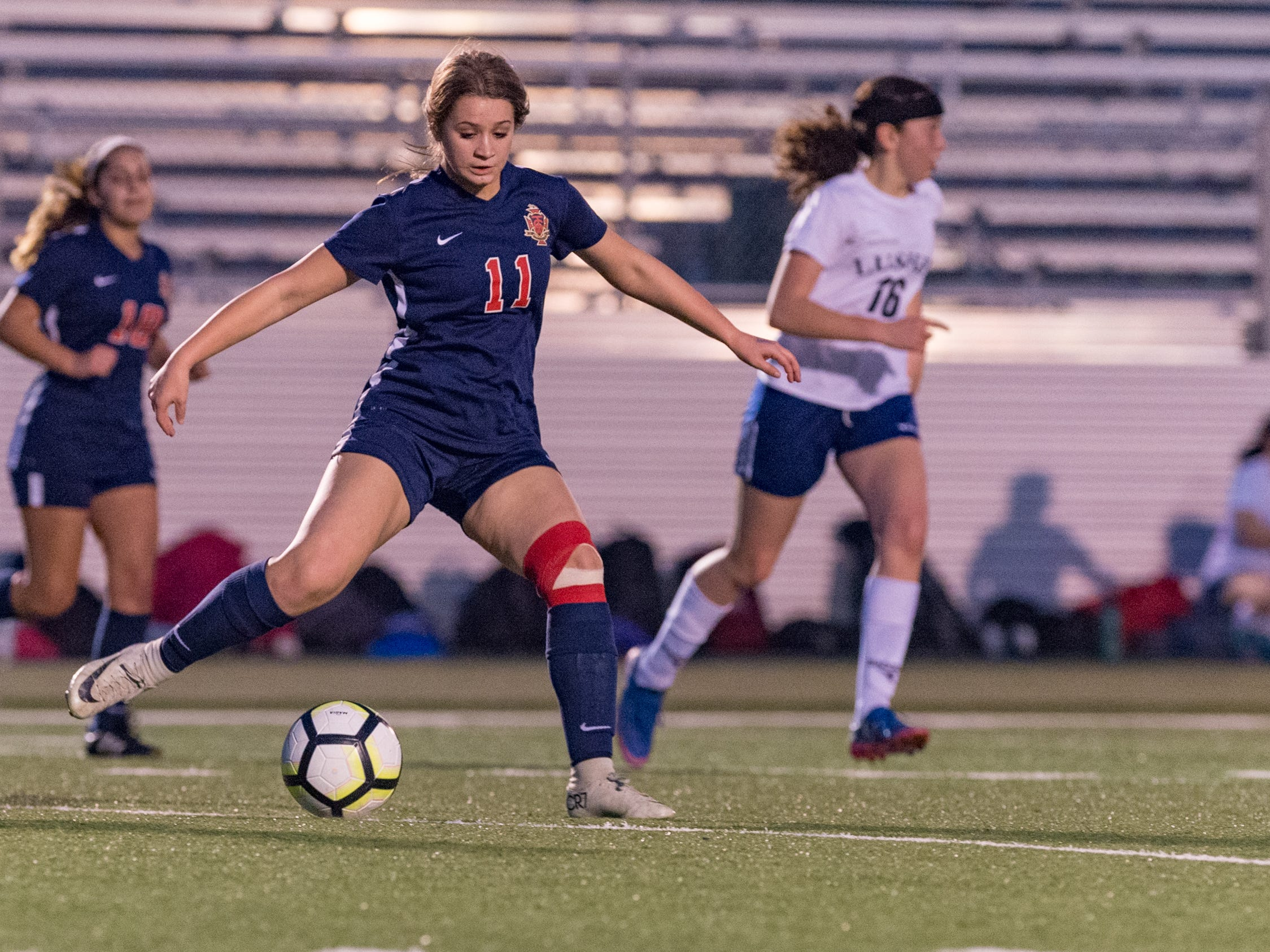 Macy Dupuis passes the ball as Teurlings Catholic shuts out Lutcher 8-0 in the second round of the LHSAA soccer playoffs.  Tuesday, Feb. 5, 2019.