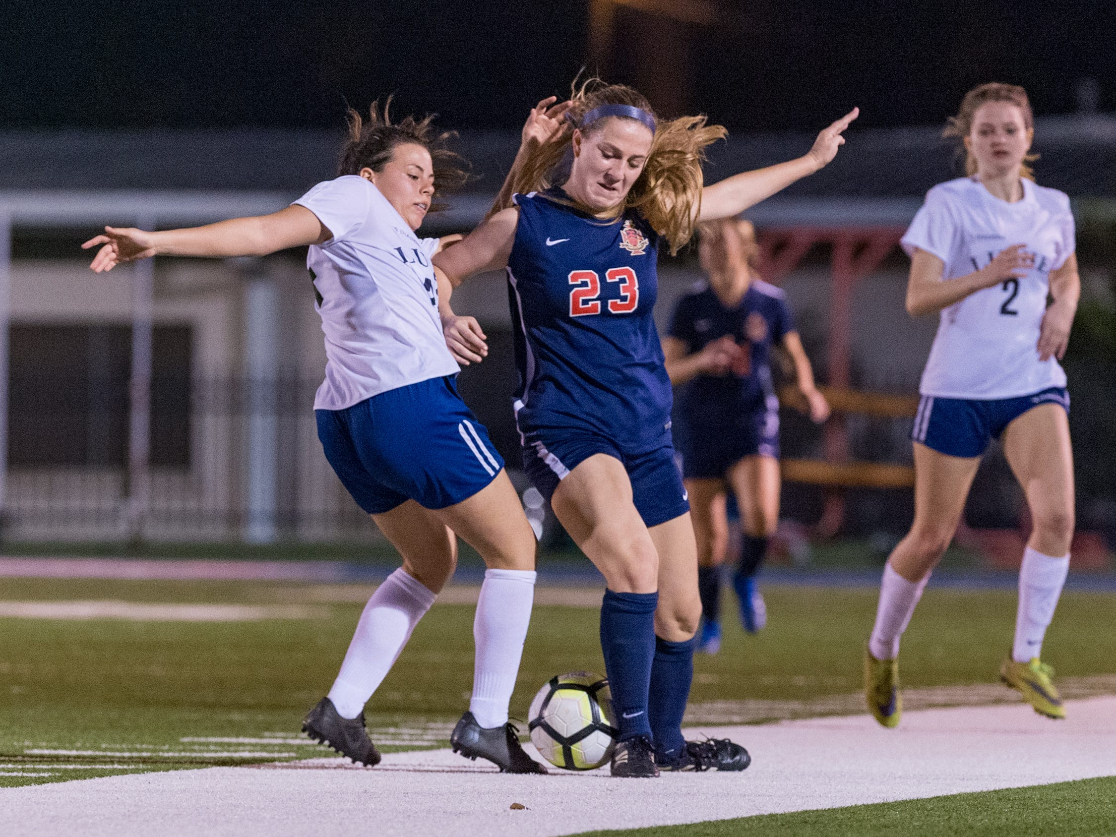 Paige Broussard battles for the ball as Teurlings Catholic shuts out Lutcher 8-0 in the second round of the LHSAA soccer playoffs.  Tuesday, Feb. 5, 2019.