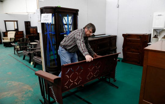 Bruce Wolfe moves furniture around one of his booths Wednesday morning, Feb. 6, 2019, at Peddler's Junction in Lancaster. The vendor market opened on Feb. 1 in the former location of Lancaster Sales.