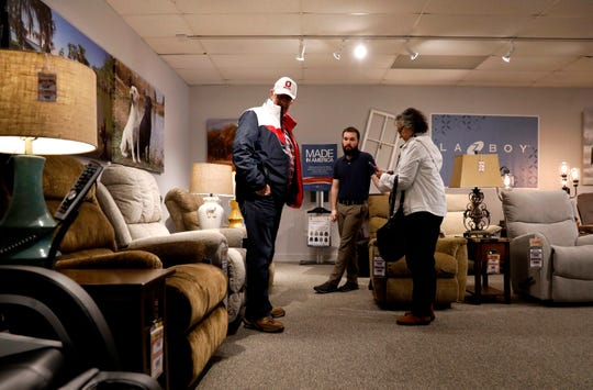 James Peterson, left, and Janet Peterson, right, talk with Nathan Cowger, manger of the Coconis Mattress 1st, Wednesday, Feb. 6, 2019, at the store on Memorial Drive in Lancaster. The recently opened store is the newest by the Zanesville-based furniture seller.