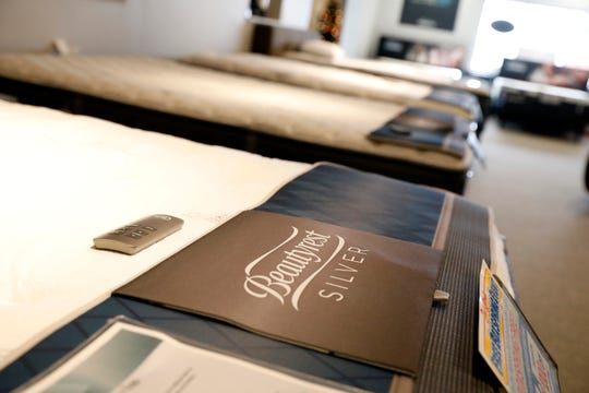 Mattresses line the showroom walls at Coconis Mattress 1st Wednesday, Feb. 6, 2019, at the store on North Memorial Drive in Lancaster.