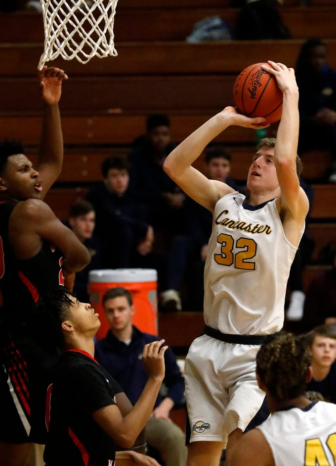 Lancaster's Tanner Roush takes a shot during Tuesday night's game, Feb. 5, 2019, against Groveport Madison at Lancaster High School in Lancaster. The Golden Gales lost the game 47-40.