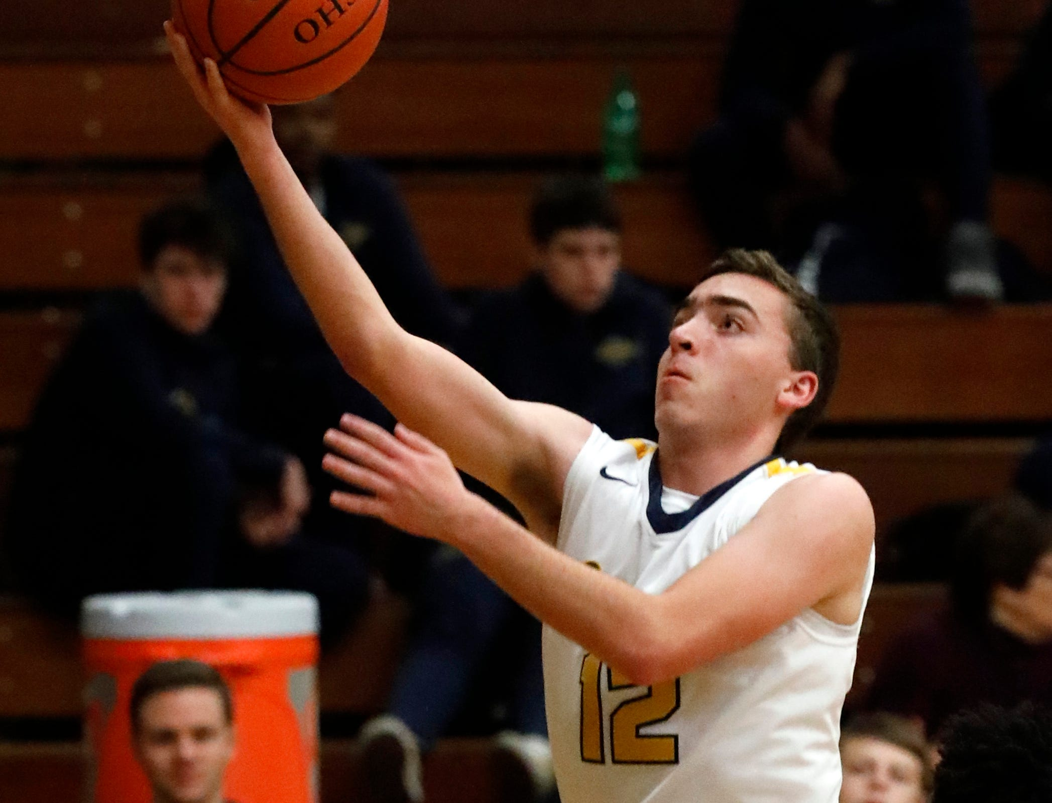 Lancaster's Brian Shupp goes in for a layup during Tuesday night's game, Feb. 5, 2019, against Groveport Madison at Lancaster High School in Lancaster. The Golden Gales lost the game 47-40.