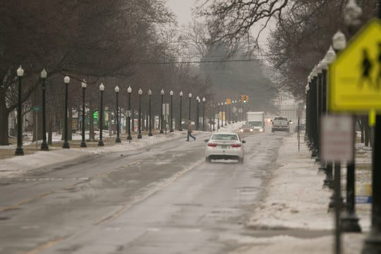 Light traffic in downtown Howell during icy conditions Wednesday, Feb. 6, 2019.