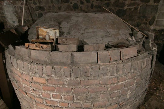 A cistern used to store water, shown Wednesday, Feb. 6, 2019, is found in the basement of the restaurant project, and may be converted into a bar.