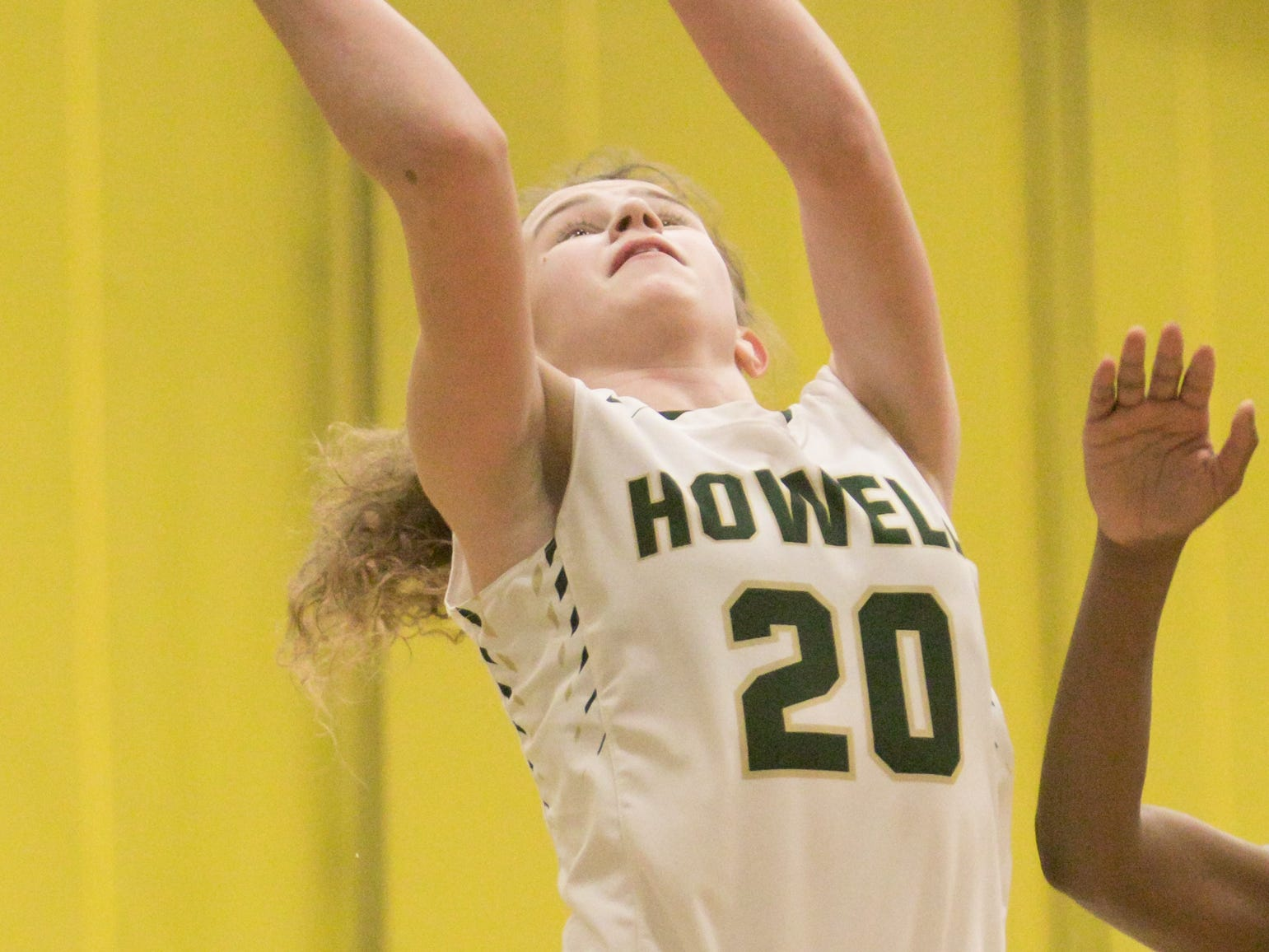 Howell's Evelyn Pennala scores in a 48-17 victory over Salem on Tuesday, Feb. 5, 2019.