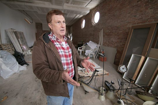 Chef Don Waldenmayer talks Wednesday, Feb. 6, 2019 about plans to convert two empty storefronts on the southeast corner of Grand River Avenue and Grand Street in Fowlerville into a restaurant called 1883 Bistro & More.