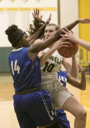 Kaylee Wendel of Howell is defended by Salem's Makela Harris in the Highlanders' 48-17 victory on Tuesday, Feb. 5, 2019.