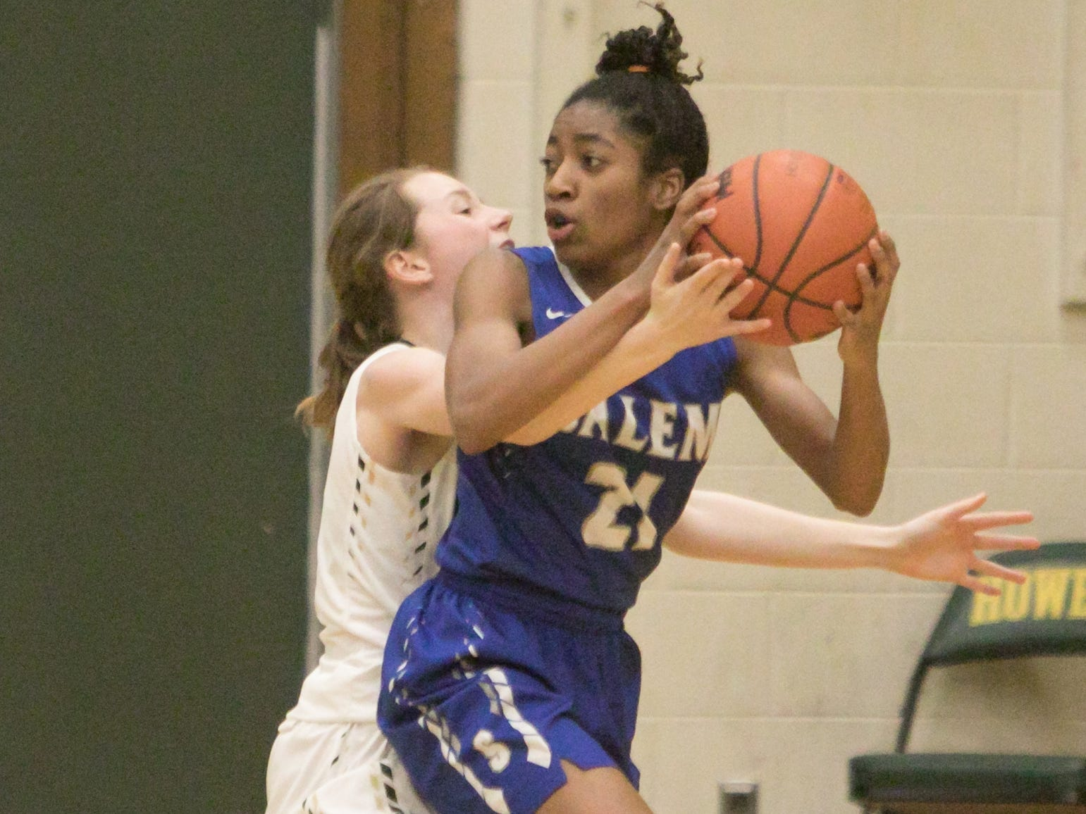 Salem's Mattison Joyner, guarded by Howell's Lillia McCurdy, had eight points, five steals and four deflections in a 48-17 loss to the Highlanders on Tuesday, Feb. 5, 2019.