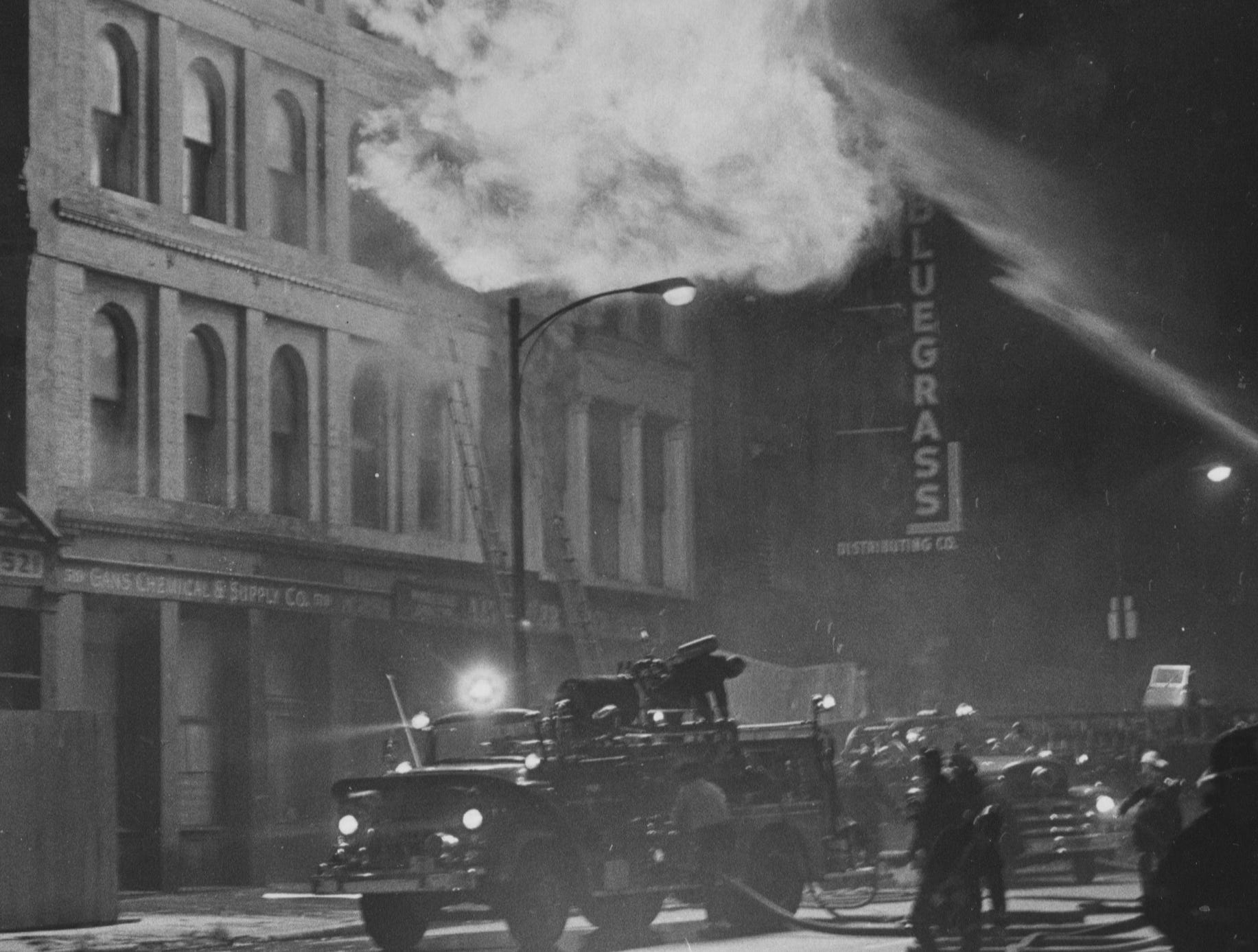 A four-alarm fire races through 515, 517 and 519 W. Main Street. 