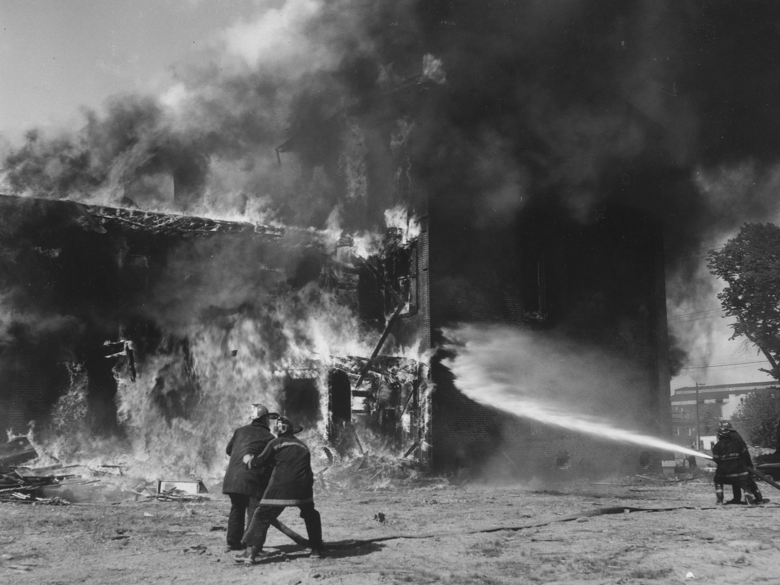 A rush job was executed by fire at 3:56 p.m. yesterday in a three-story, 530 S. English brick building slated for razing by Urban Renewal. 
