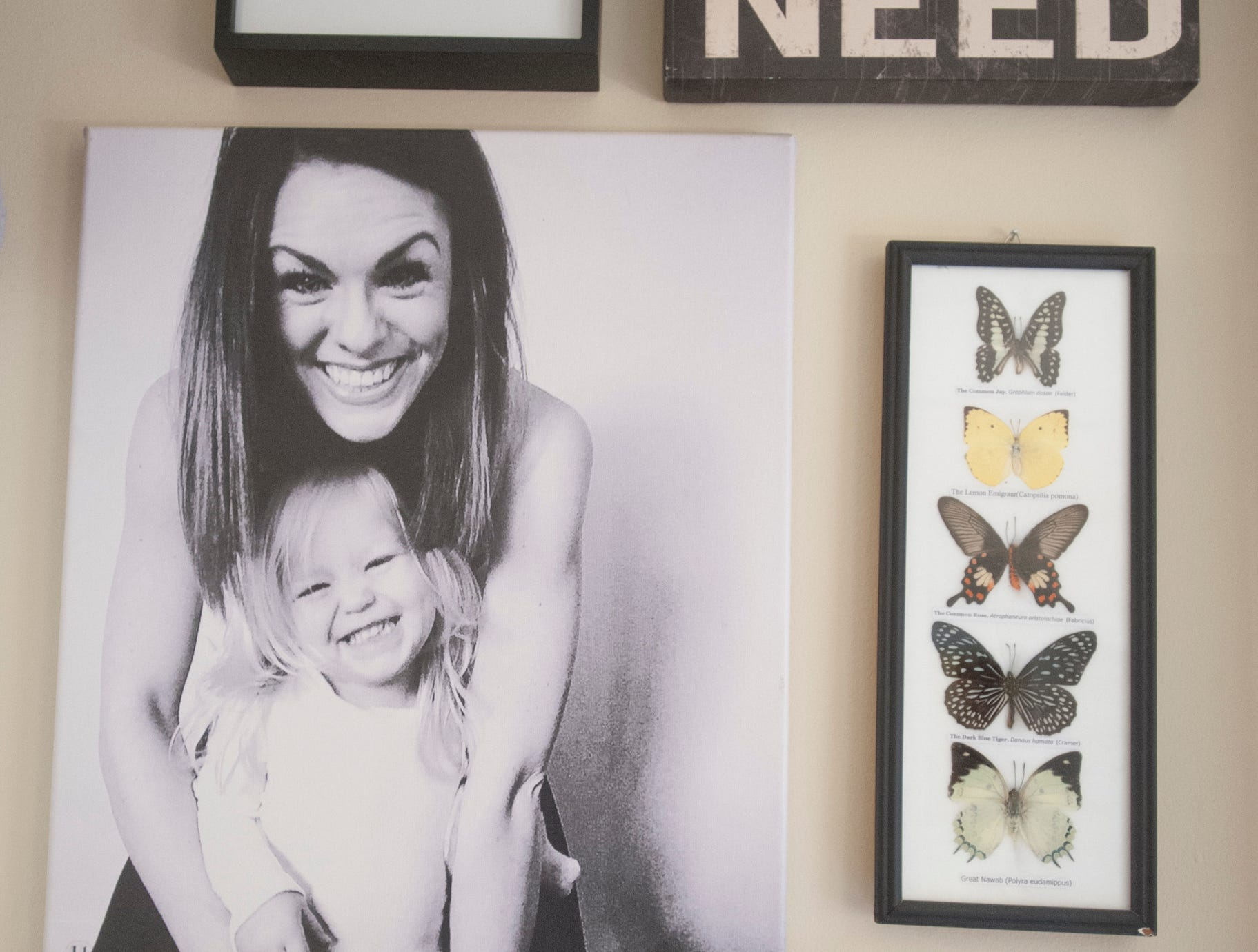 A wall in Lennox' bedroom includes a portrait of Lennox and her mom.