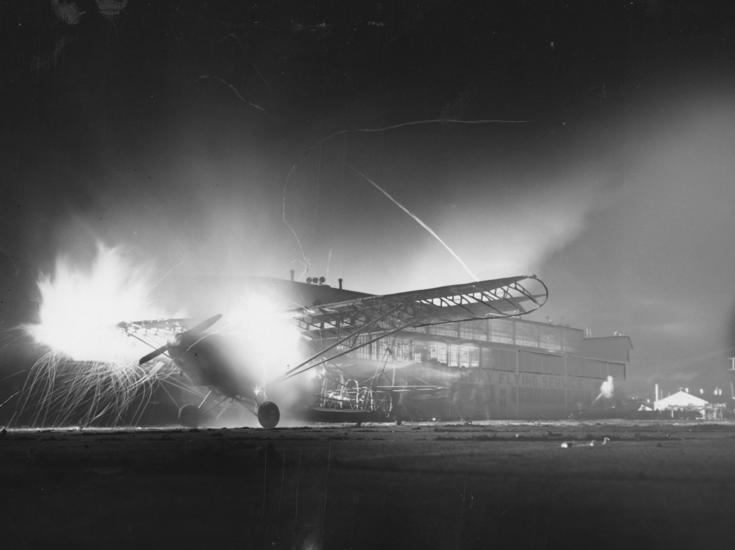 Flying sparks etch streaks in the night air as a private plane burn at Bowman Field. 