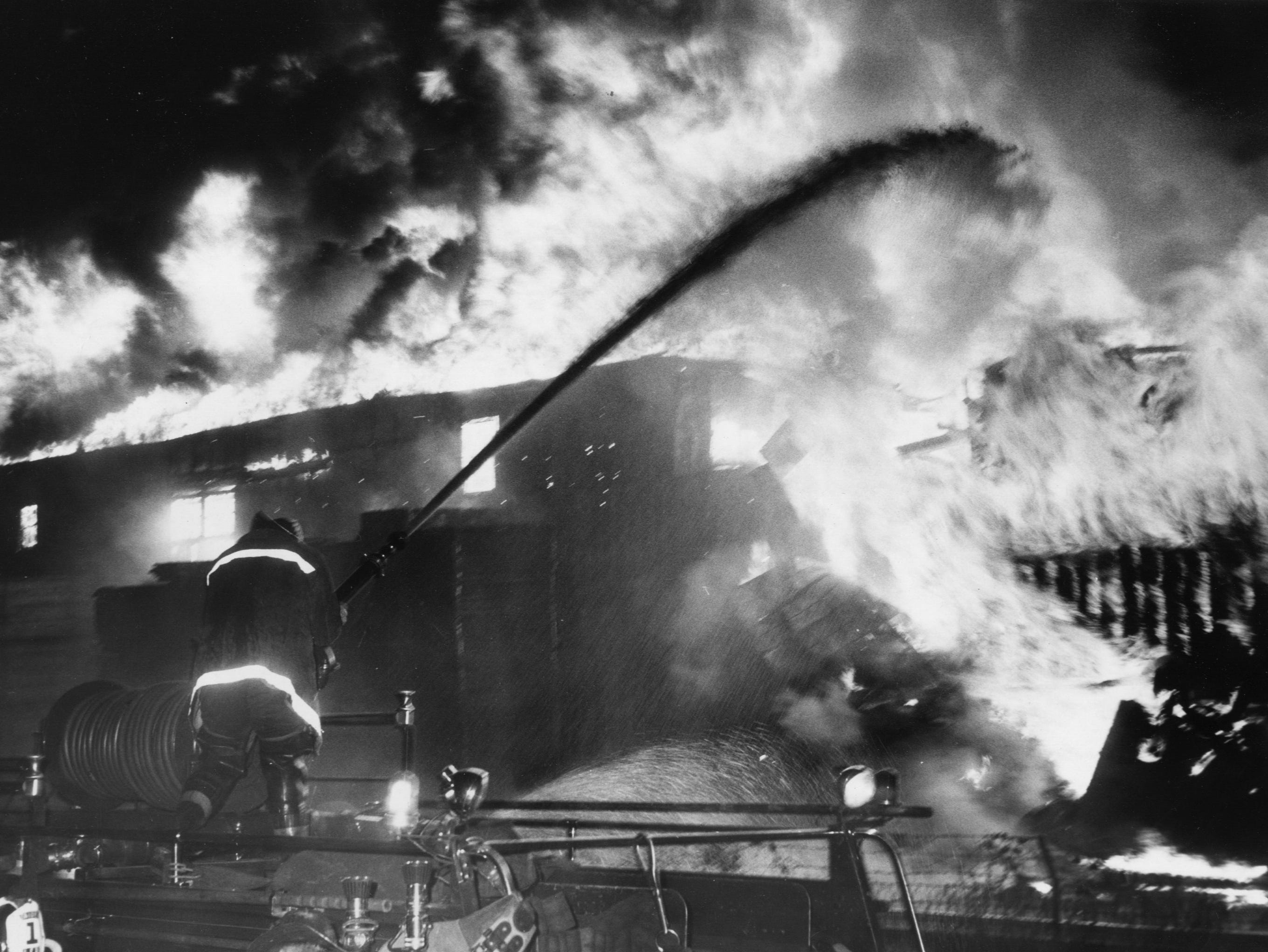 A four-alarm fire at Sash & Dash Co. ad Kentucky Lumber Co.