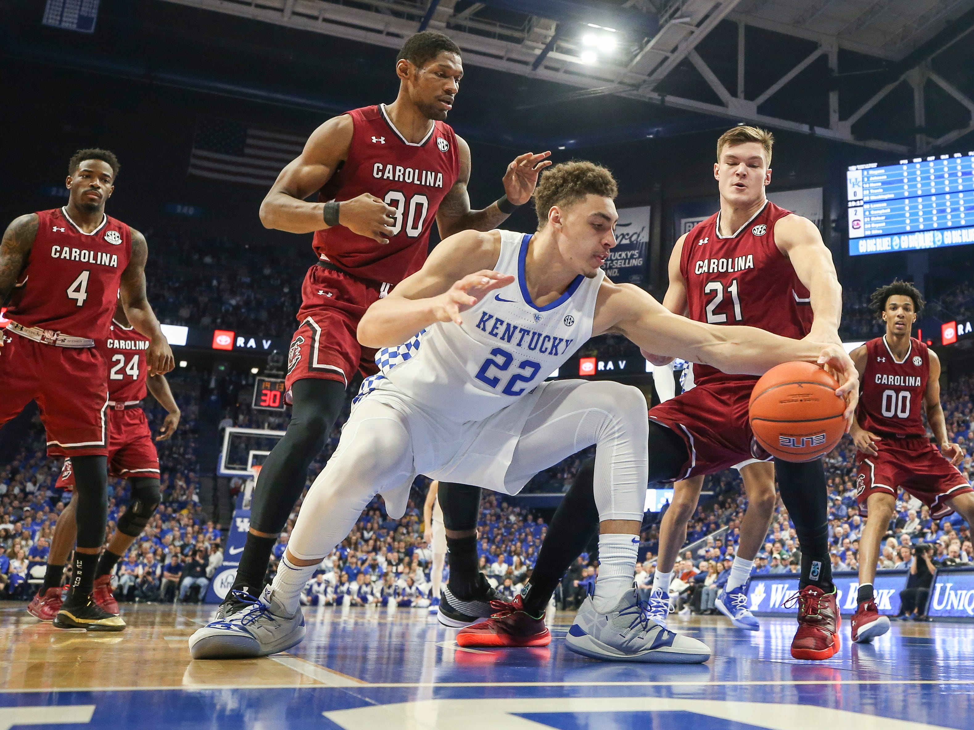 Kentucky's Reid Travis tries to grab a loose ball in the first half Tuesday night against South Carolina at Rupp Arena. Feb. 5, 2019